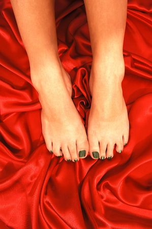 Bare feet on red. photo
