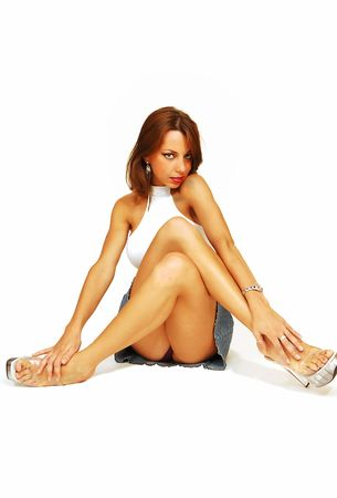 Sitting woman in jeans skirt.  photo