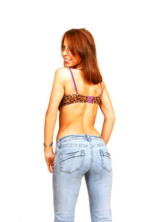 Standing woman in bra and jeans.