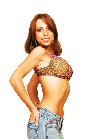 Standing woman in bra and jeans. photo
