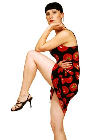Standing woman in tomato dress. photo