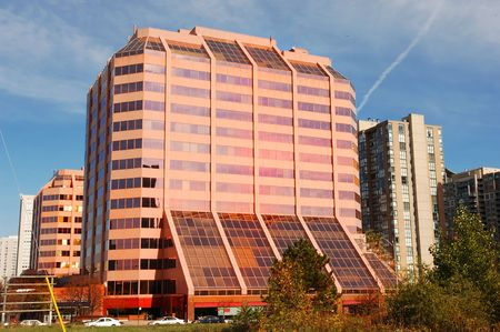 A very nice looking pink glass and concrete office building in downtown of Mississauga.