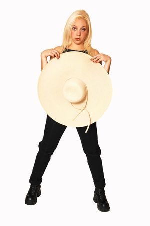 Happy young girl smiling with a big beige straw hat, black top and jeans. Stock Photo - 3859808