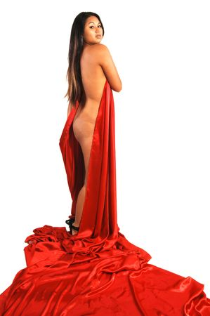 An nude Asian girl with red silk fabric, long black hair, shooing her very nice backside and her beautiful round bum.  Stockfoto
