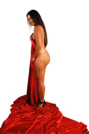 An pretty Asian woman standing naked with her long black hair holding a red silk fabric to cover her front. Stock Photo - 4127250