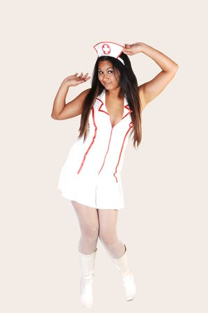 sexy asian woman: Young Asian woman with long black hair and white fish net stockings and boots in a nurse uniform on light gray background. Stock Photo