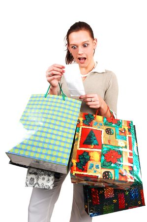 A young woman back from an shopping spree realized that she spend much to mach money in the stores.  photo