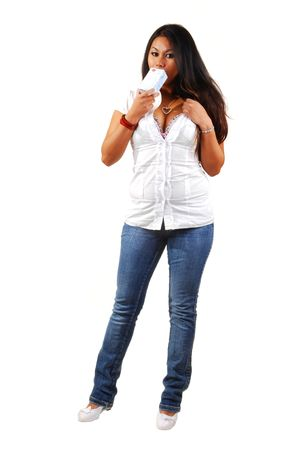 tight fit: Young Asian woman holding her drink in front of the camera, in tight jeans and white blouse.. Stock Photo