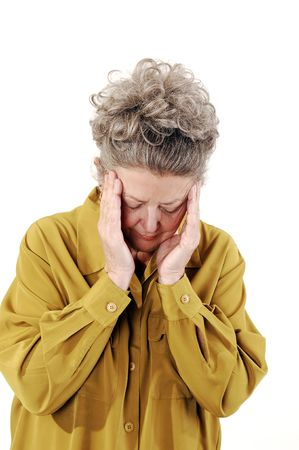 Senior woman with gray hair and an dark yellow jacket holding her head with a teripple headache. On white background. photo