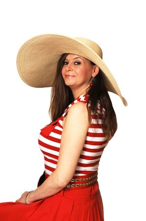 Pretty woman with long brown hair sitting on a chair for a portrait with a big  yellow hat and red dress for light white background and looking, smiling in the  camera. Nice figure. Stock Photo - 4796443