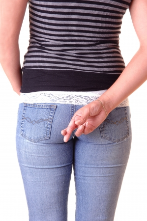 The back of a young girl, in a gray top and blue jeans, with the nice round butt and the right hand with the grossed fingers.