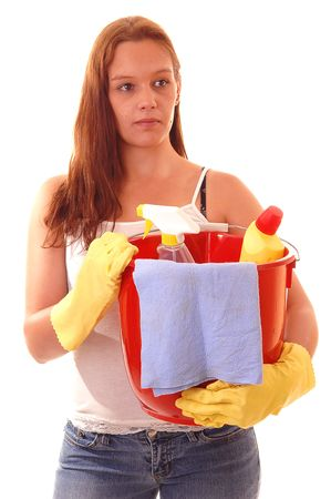 Young woman with a red peel, yellow rubber cloves and cleaning staff with long auburn hair in t-shirt and jeans is going to clean the house. photo