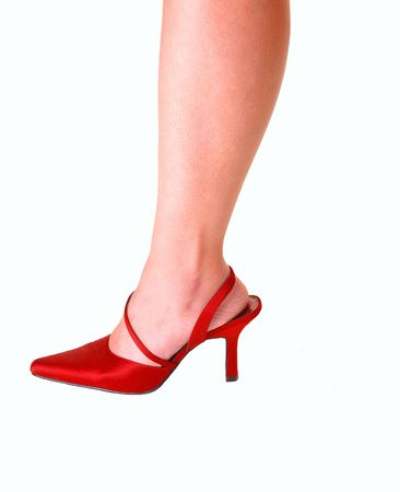 Young womans leg in red high heels for light blue background. Stock Photo - 5014521