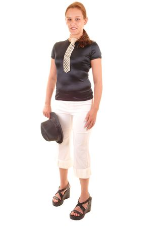 An all dressed up woman in black blouse and white trousers, with a hat in her hand and a necktie made from white pearls, for white background.  photo