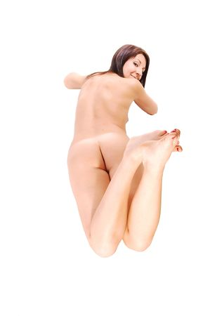 Pretty young naked girl lying on the floor shooing her back and the bum with her perfect slim body, for white background. Stock Photo - 5389249