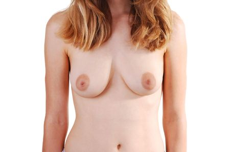 The chest and tummy of a young nude woman with light red hair, shooing her nice breasts and the flat tummy. On white background. Stock Photo