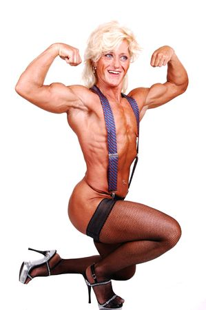 suspender: A blond muscular bodybuilding girl kneeling in the studio shooing her strong legs and the upper body and arms, with suspender, over white background. Stock Photo