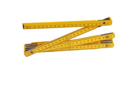 An foldable yellow European ruler, two meter long, on white background.