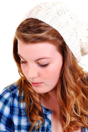 A pretty face with a white hat on her blond red hair in closeup, looking down on the floor, for white background. Stock Photo - 6519371