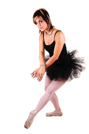 An lovely, pretty young ballerina in a black twill dress with white pantyhose dancing in the studio for white background. Stock Photo - 6764239