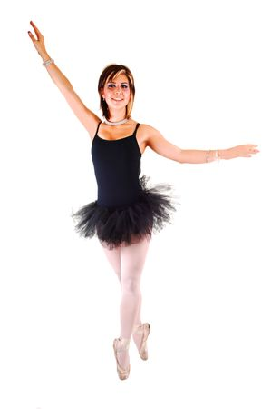 An lovely, pretty young ballerina in a black twill dress with white pantyhose dancing in the studio on her toe, for white background. Stock Photo - 6764236