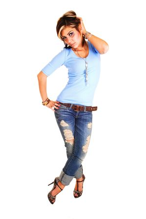 A pretty tall young girl standing with her front to the camera,  in high heels, jeans and blue sweater for white background. photo