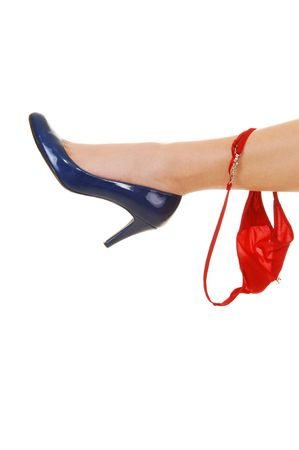 One leg with a blue high heel and a red thong hanging on for white background. Stock Photo - 6848495