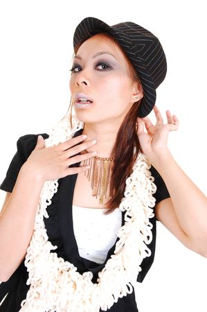 A pretty Chinese woman with a hat and an fussy scarf around her neck in a black jacket, standing in the studio for white background. photo