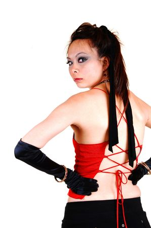 Pretty Asian pirate girl in black cloves and short skirt with a red top  from the back, looking over her shoulder, for white background. photo