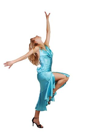 sexy girl dance: A beautiful blond and tall woman in a light blue dress and high heels is dancing in the studio for white background.