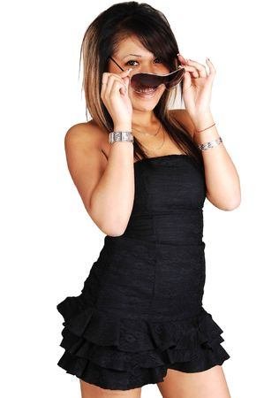 A young pretty Asian woman standing in a black short dress, holding  her sunglasses in her face, with short hair on white background. Stock Photo - 7037875