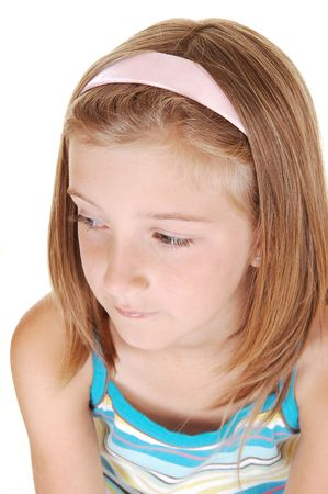 Closeup of a very pretty young girl with blond hair, looking away fromthe camera, on white background. Stock Photo - 7333672