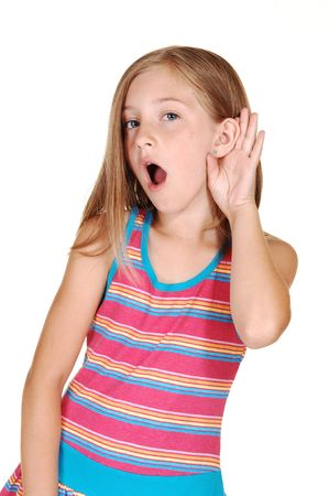 A pretty young girl with long blond hair can not understand what is sat to her, she hold her hand behind her ear with her mouth open, over white.