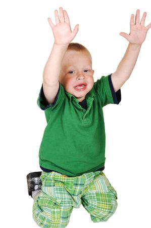 A lovely toddler kneeling on the floor in the studio holding up his hands, on white background. Stock Photo - 7526589
