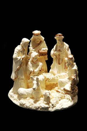 A small nativity scene with Maria, Joseph and the 3 Wiseman made from porcelain, on black background. Reklamní fotografie