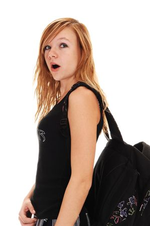 A young teenager with her back bag over her shoulder on the way to school, on white background. Stock Photo - 8065163