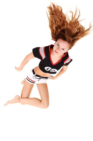 A young teenage soccer girl lying on the floor in her uniform, for a portrait in the studio, over white background. Stock Photo - 8068177