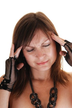 A middle aged woman holding her fingers on her head, she has a severe headache. photo