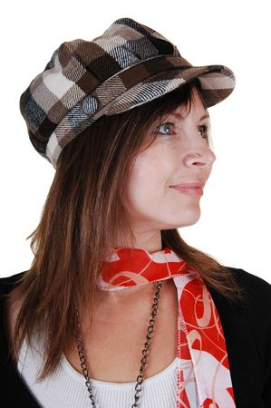 An middle aged woman in an black sweater and a gray brown hat standing in the studio with a red scarf, for white background. photo