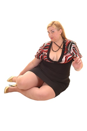 plus size woman: An heavy woman sitting on the floor in a black dress, for white background.