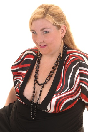 An big overweight woman in a black dress sitting on the floor in the studio, for white background. photo