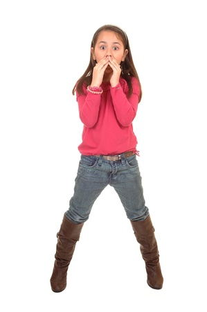A young girl in jeans and a pink sweater and boots holding her moths because she talked to much, for white background. Stock Photo