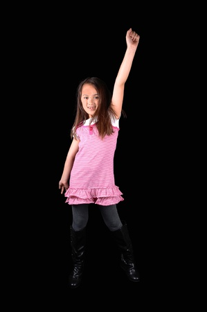 A young girl in tights and a pink dress and boots holding her arm up and is very happy, for white background. Zdjęcie Seryjne - 9068893