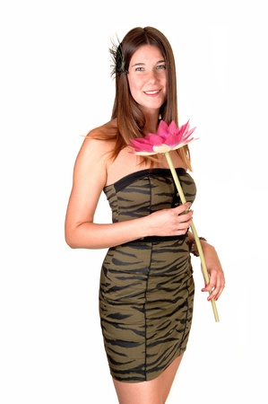 A pretty teenage girl in a strapless olive green tight dress with a pink flowerin her hand and long dark blond hair, for white background. photo