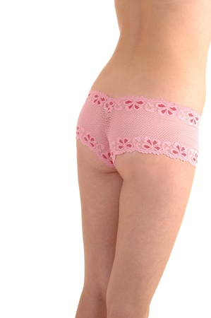 The back and the bottom of a sling young woman with nice pick lacepanties from the back, for white background. photo
