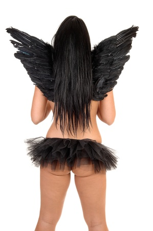 A woman from the back with black long hair and black angel wings,and with a short black twill skirt and thongs, for white background. photo