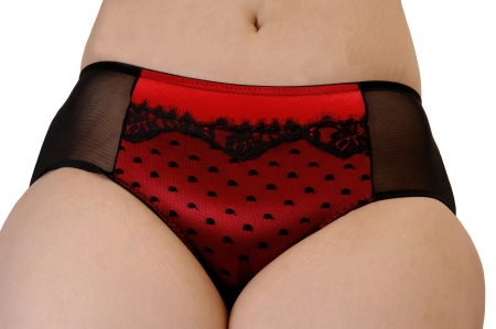 The black and red panties in closeup of a heavy woman with partof her legs and stomach, for white background. photo
