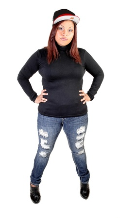 empty handed: A young Hispanic woman in ripped jeans, an black sweater, boots and abasket ball cap, standing for white background with her red hair.
