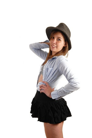 A young pretty woman with a gray hat, short black skirt and lightblue shirt having fun with the photo shoot, for white background  photo