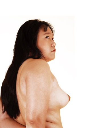 nice breast: The profile view of a pretty Asian woman topless and with long blackhair, showing her nice breast, for white background  Stock Photo